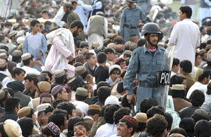 Afghan National Police Officers patrol the crowds gathered for a concert to celebrate Nawruz, the Afghan New Year, at the Karzai stadium in Lashkar Gah