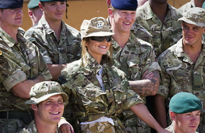 Cheryl Cole poses with members of the 3 Commando Brigade Reconnaissance Force during her visit to Camp Bastion