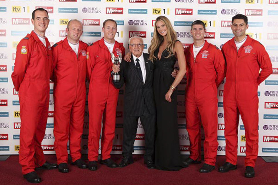From left: Flight Lieutenant Dave Davies, Squadron Leader Ross Priday, Flight Lieutenant Sean Cunningham, Tom Lackey, Elle Macpherson, Flight Lieutenant Zane Sennett and Flight Lieutenant David Montenegro at the Daily Mirror's Pride of Britain Awards 2011