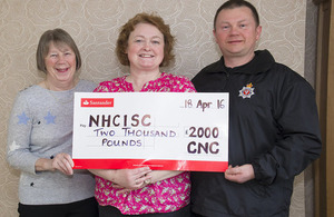 The cheque being presented to the North Highland Cancer Information and Support Centre