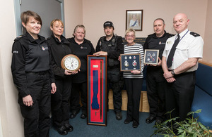 Pictured left to right: PC Gill Coghill, Sgt Jacqueline Mackay, Sgt Karen Tadd, Sgt Chris Donaghy, Mrs Williams-Blake, Sgt Paul Brown and Supt Martin O'Kane
