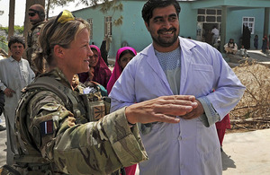 Sergeant Karen Swallow RAF with Dr Abdul Latif, the driving force behind the renovation of Gereshk District Hospital, in front of the new maternity wing