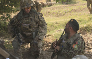 An Afghan warrior briefs a British soldier during Operation BIG FISH