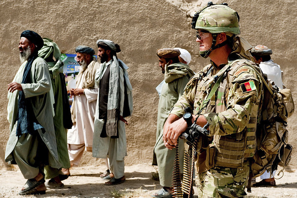 A member of the Police Mentoring Troop during a routine patrol around Sangin's bazaar