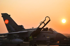 A Tornado GR4 aircraft is pictured against an Italian sunset at Gioia del Colle air base