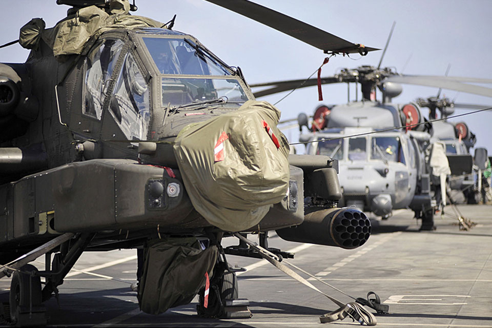 Army Air Corps Apache and United States Air Force HH60 helicopters on board HMS Ocean, supporting Operation UNIFIED PROTECTOR in the Mediterranean