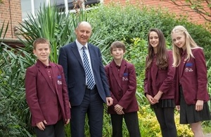 Image: Headteacher and pupils