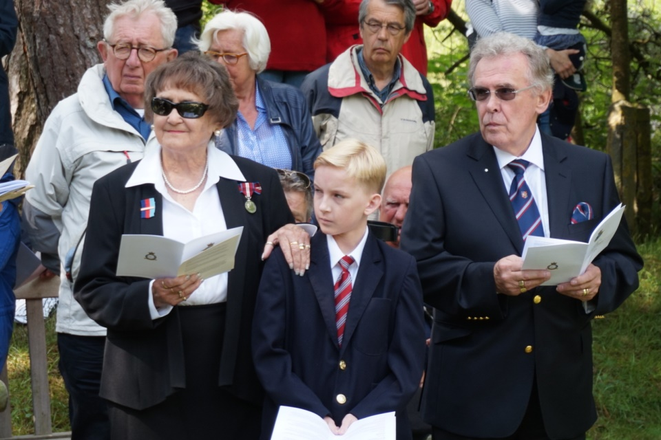 Cox family at the service, Crown Copyright. All rights reserved.