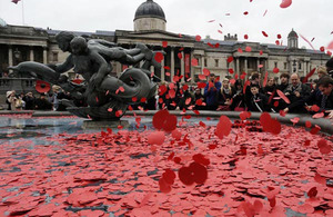 Poppies are thrown into one of the fountains in Trafalgar Square, London, following the two-minute silence for Armistice Day