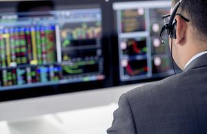 A broker using a computer