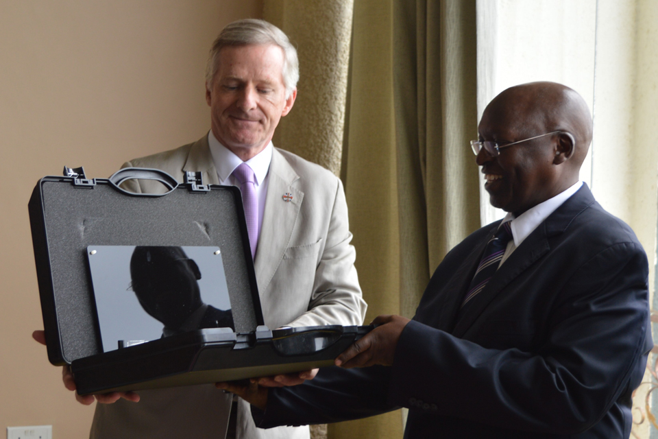 Handover of security equipment to CAA official