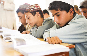 Student Samiullah (right) attending a lesson at Nad 'Ali Central School in Helmand province, Afghanistan