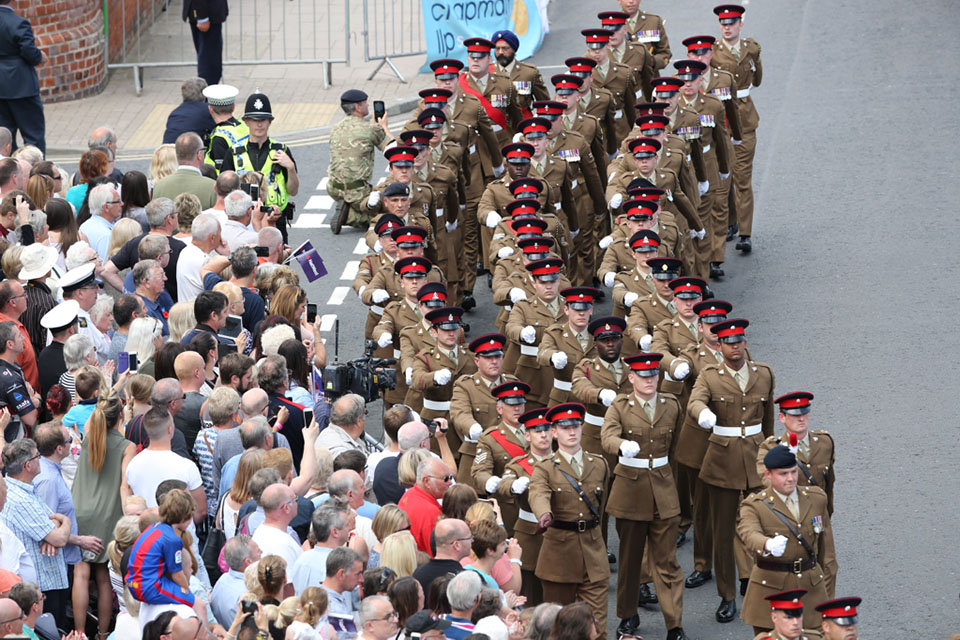 Crowds cheer as the Armed Forces parade in Cleethorpes