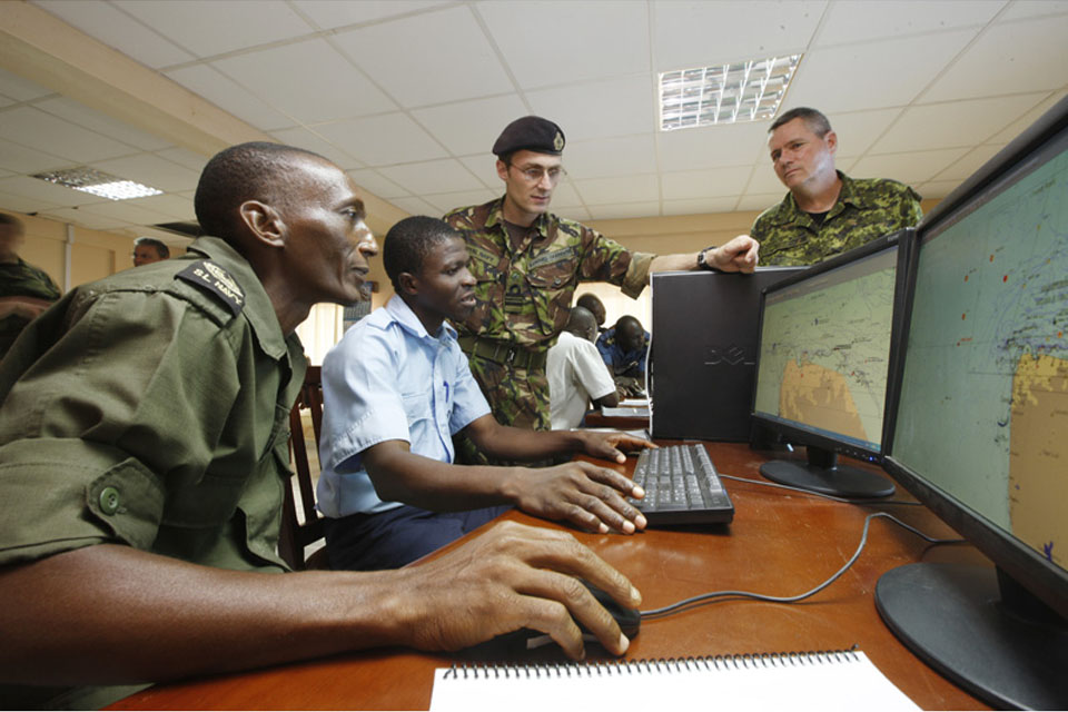 Overseen by Royal Navy Lieutenant Commander Edward Carpenter and Canadian Navy Chief Petty Officer Second Class Steve Smith, Sierra Leone navy personnel monitor a radar tracking system, watching for illegal maritime movements including drug trafficking, o