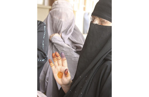 An Afghan woman has decorated her hand to hide the ink stain which shows that she has ignored Taliban threats and voted in the Afghan parliamentary elections (stock image)