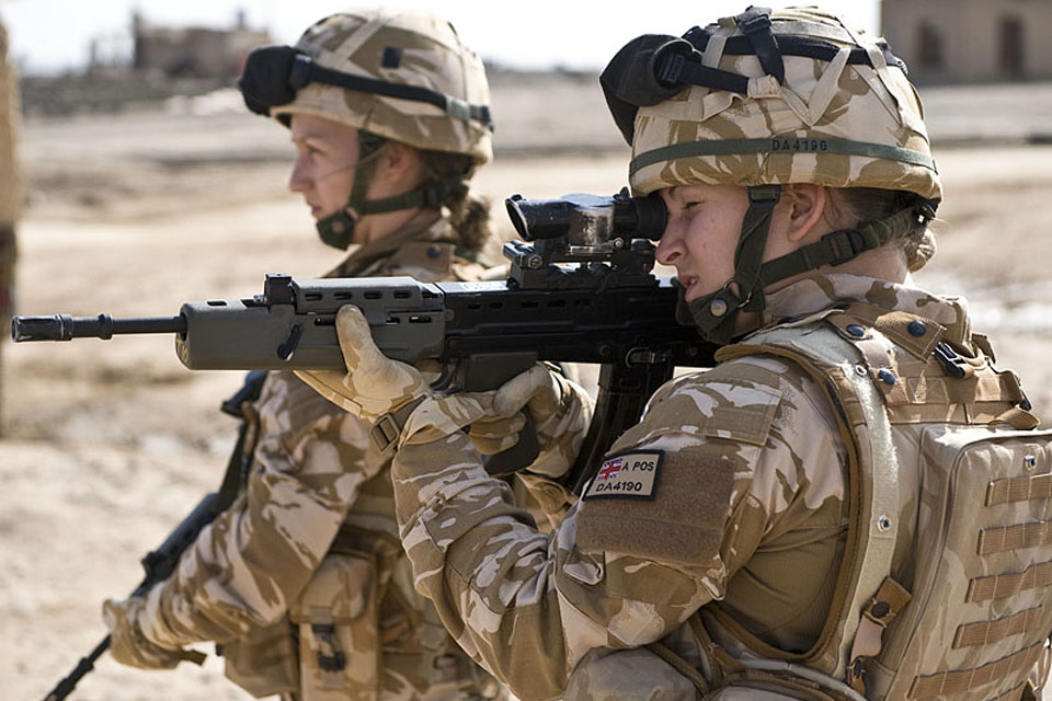 Two female British soldiers are pictured on patrol in Lashkar Gah, Helmand, southern Afghanistan (stock image)