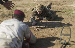 A British soldier teaches an Iraqi soldier how to expose an improvised explosive device during breaching training. Combined Joint Task Force - Operation Inherent Resolve Copyright.