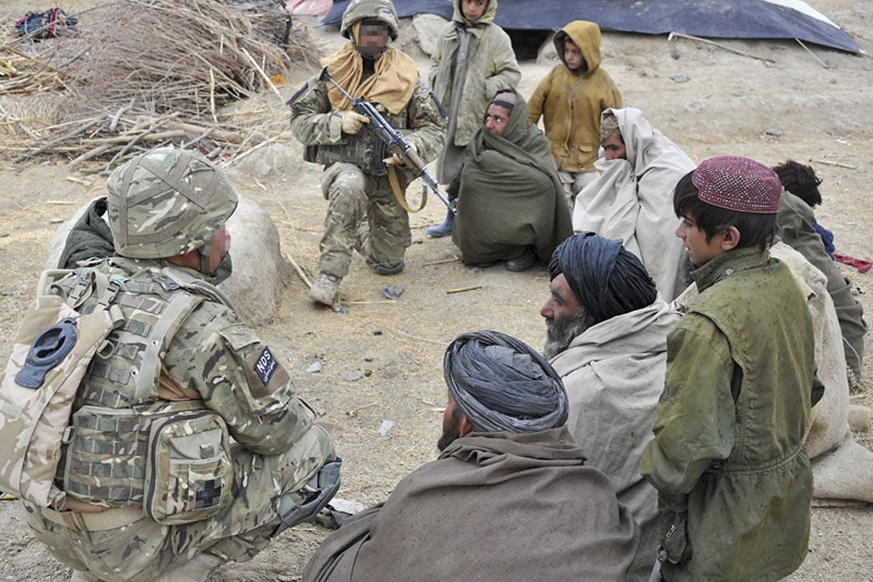 Afghan police gathering information on insurgent activity in the area