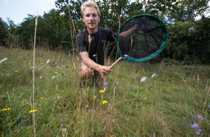 Former Natural England apprentice and now Kingley Vale NNR Reserve Manager, surveying bees and butterflies on the Kingley Vale NNR © Steve Walker