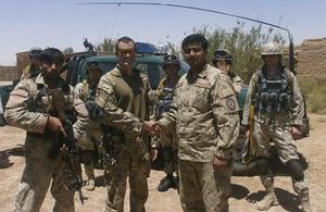 Major Adam Wolfe shakes hands with the new Commander of Patrol Base Silab, Lieutenant Haji Zainoulla