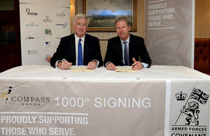 Compass Group UK & Ireland Managing Director Dennis Hogan signs the Armed Forces Covenant with Defence Secretary Michael Fallon.