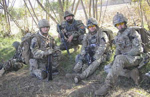 Soldiers from 1st The Queen's Dragoon Guards working alongside Afghan National Army colleagues in Nad 'Ali