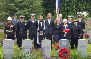 AB Dobson's niece Joan Loftus holding the Union Flag whilst accompanied by family members and representatives from Ship's Company. Crown Copyright. All rights reserved.