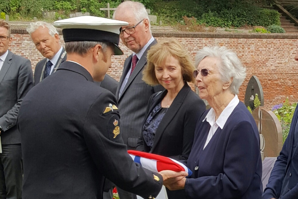 AB Dobson's niece Joan Loftus receiving the Union Flag. Crown Copyright. All rights reserved.
