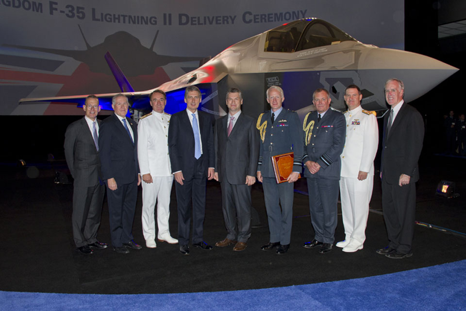 Royal Navy Fleet Commander, Admiral Sir George Zambellas, third from left, Defence Secretary Philip Hammond, fourth from left, and the Chief of the Air Staff, Air Chief Marshal Sir Stephen Dalton, fourth from right, pose alongside trans-Atlantic colleague