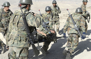 Afghan National Army Officer Candidate School students simulate evacuating an injured soldier during a field training exercise at Camp Alamo in Kabul, Afghanistan (stock image)