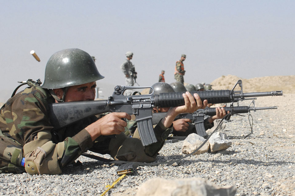 A member of the Officer Candidate School for the Afghan National Army learns basic rifle marksmanship on a range at Kabul Military Training Centre overseen by members of the US and British Armed Forces (stock image)