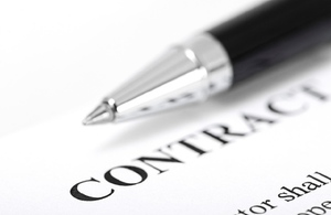 close up of a pen on top of a contract