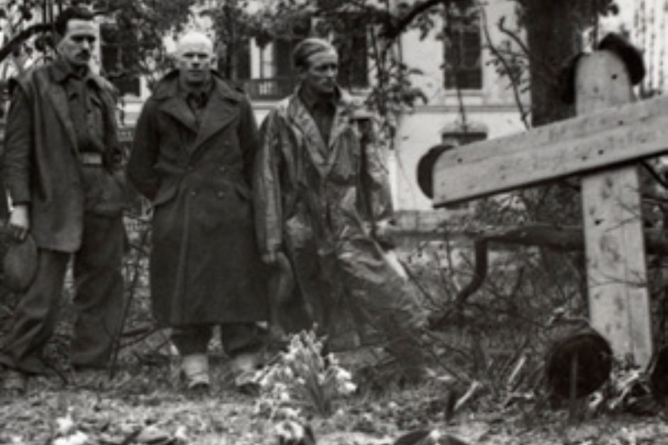 British Soldiers standing respectfully at a grave in Arnhem, 1944, Crown Copyright