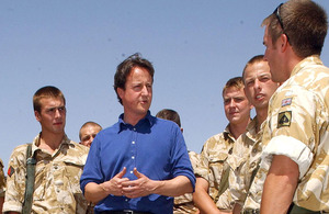 David Cameron talks with British soldiers during a visit to Afghanistan