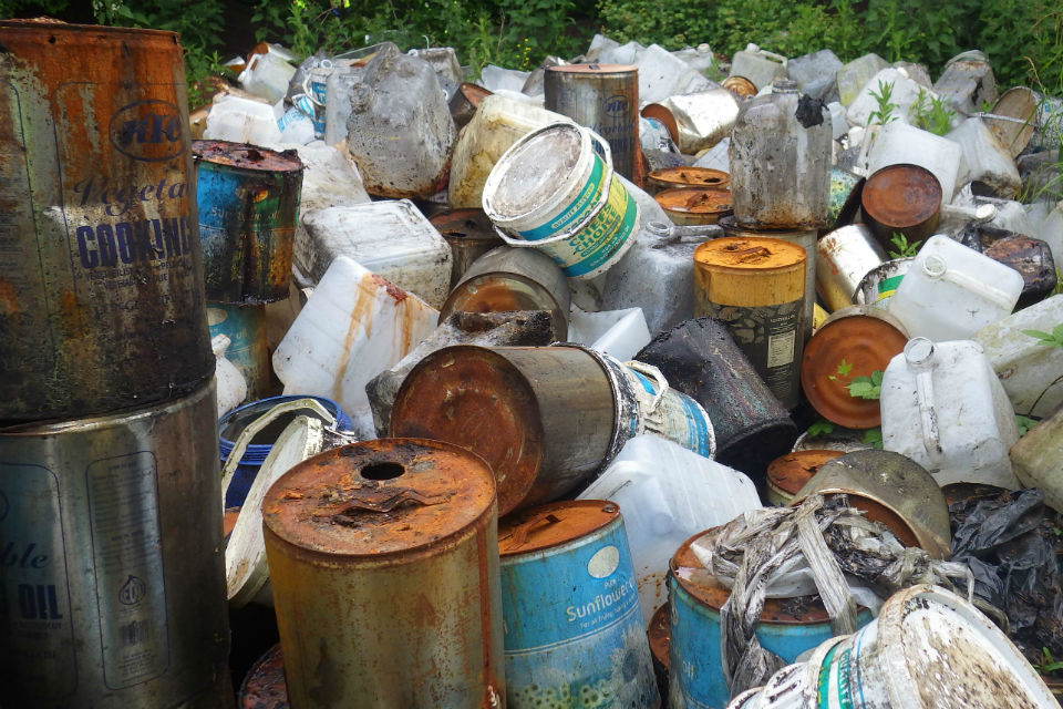 Stacked tins of cooking oil