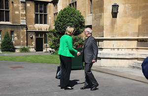 Home Secretary shaking hands with the Archbishop of Canterbury
