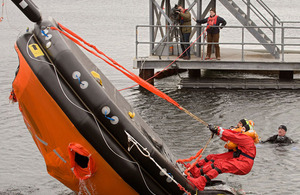Righting an inflatable life raft
