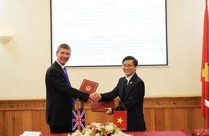 British Ambassador Giles Lever and Vice Minister of Justice Nguyen Khanh Ngoc at the signing ceremony