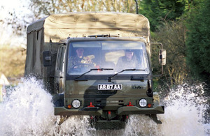 A military truck makes its way through flood water
