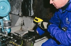 Surveyor in engine room