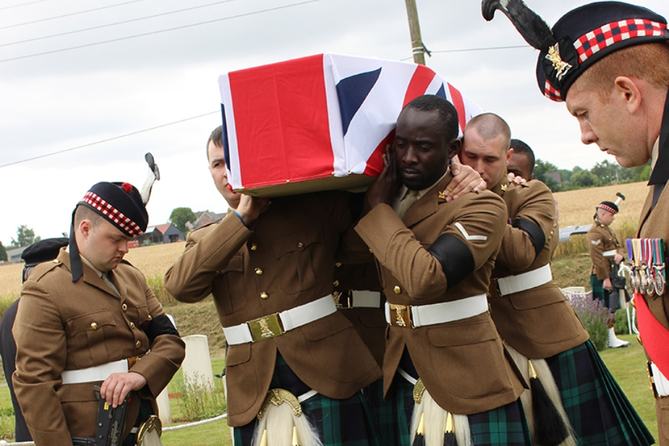 Current members of The Black Watch bring LCpl Morrison into the cemetery (Crown Copyright) All rights reserved