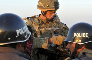 Lieutenant Luke McDonagh of D Company, 5 SCOTS, briefs his Afghan National Police colleagues on the plan of action