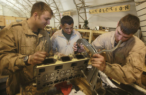 From left: Craftsman Adam Evans, Corporal Lorenzo Arebalos and Lance Corporal Craig Heaton repair an automotive component at the Intermediate Maintenance Activity lot in Camp Leatherneck
