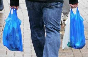 Shopper with plastic carrier bags