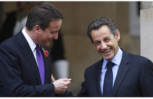 French President Nicolas Sarkozy (right) talks with British Prime Minister David Cameron as they arrive at Lancaster House in London