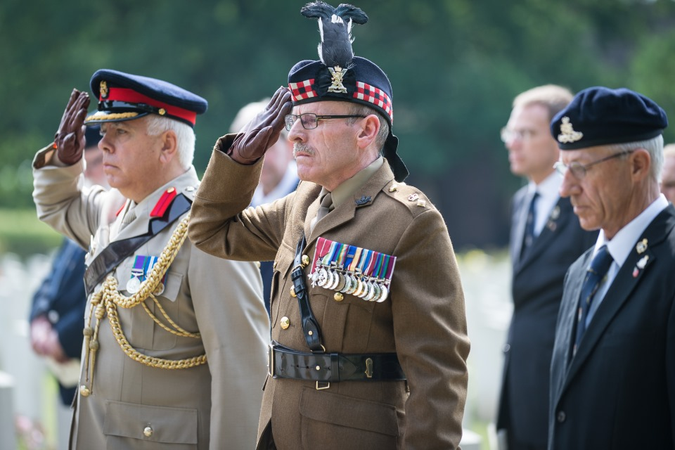 Army officials pay their respects to Major Wadeson and Lieutenant Mackenzie (Crown Copyright). All rights reserved.