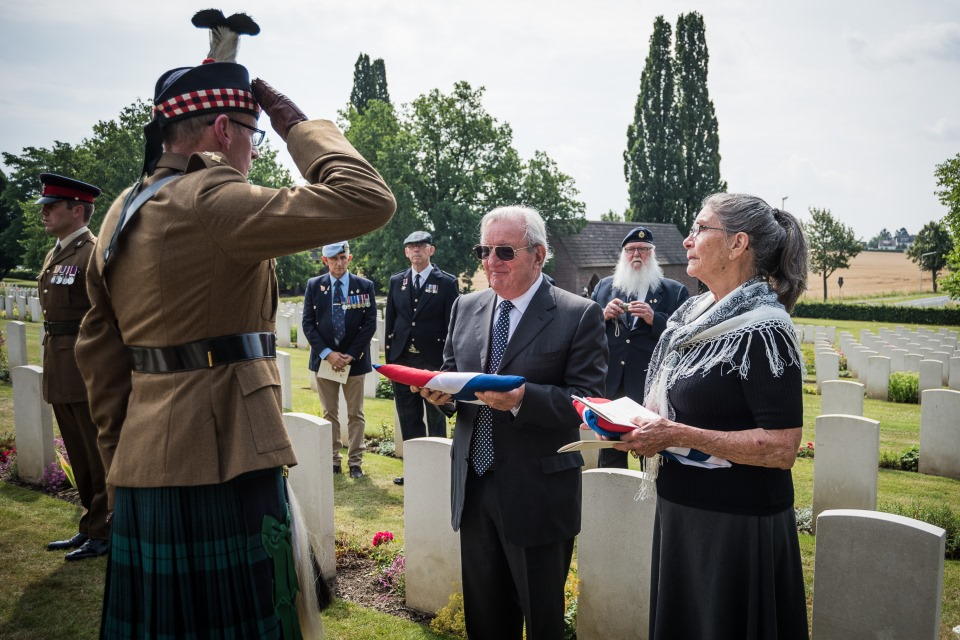 Tim Wadeson, son of Major Wadeson is presented with the Union Flag (Crown Copyright). All rights reserved