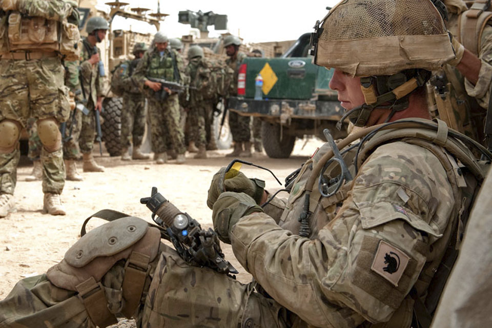 British and Afghan troops muster in a compound in Nad 'Ali, Helmand province, on Day 2 of Op TOR SHEZADA