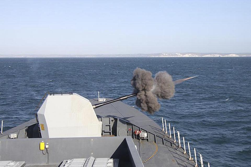 HMS Daring fires her 4.5-inch (114mm) gun during Operational Sea Training
