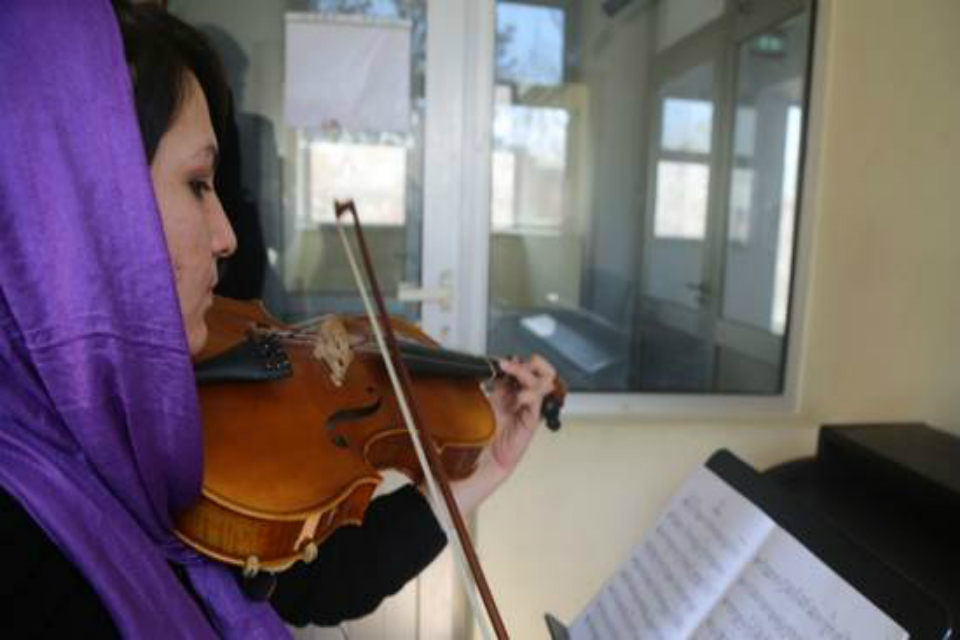 Afghan girl playing violin at ANIM